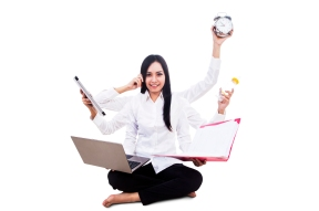 Businesswoman multitasking isolated